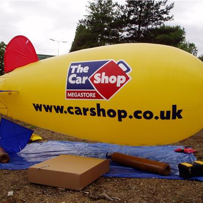 The Car Shop Yellow Blimp- inflated and ready to fly!
